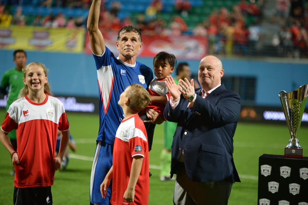Aleksandar Duric waves at the stands. The match acted as his testimonial match following his retirement on 31 October 2014. Next to him is Chris Comer, CEO and Property Developer, Castlewood Group